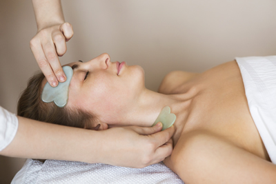 Gua Sha treatment using jade massage tool